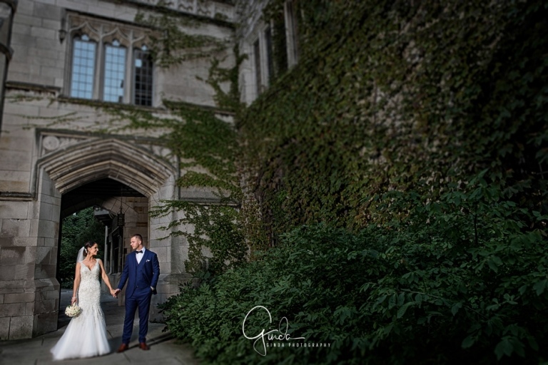 university of chicago wedding photos married couple holding hands