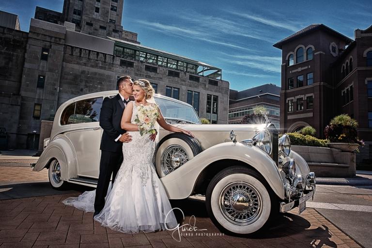 Madonna Della Strada Wedding couple posing by royce rolls