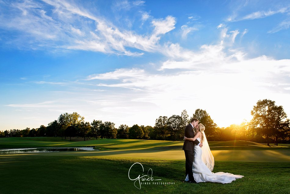 couple kissing at a golf club in st. charles wedding