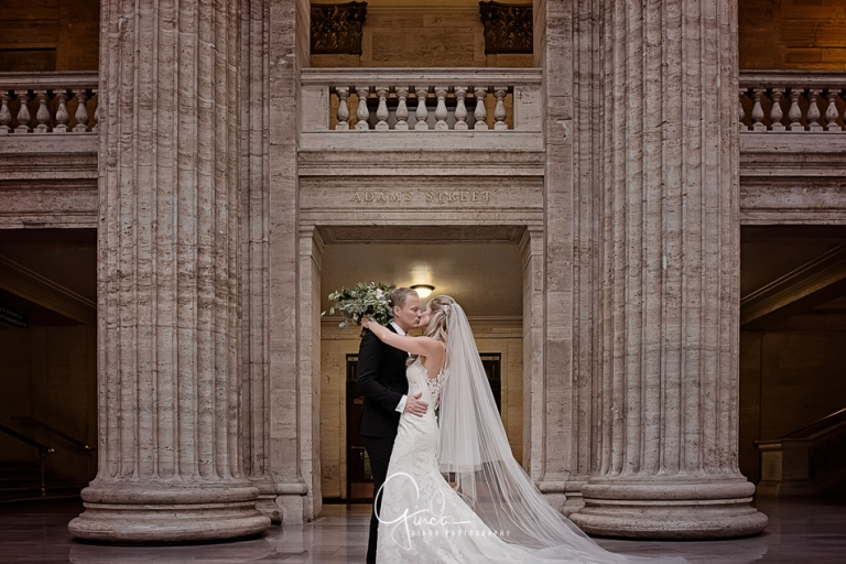 Downtown Chicago Wedding Photography couple kissing at union station