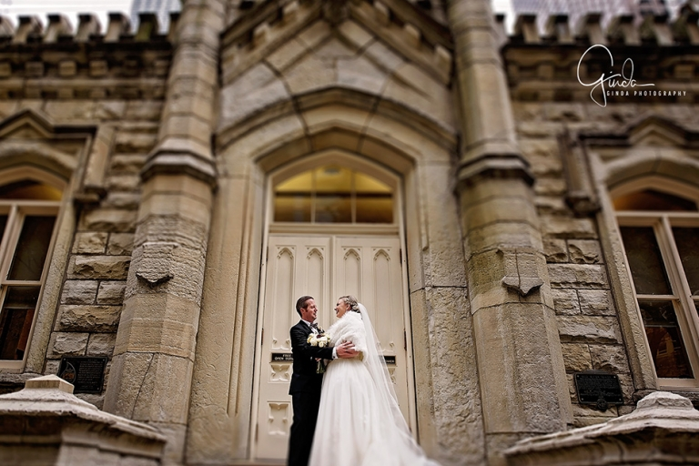 holiday season chicago wedding couple posing near water tower buildings