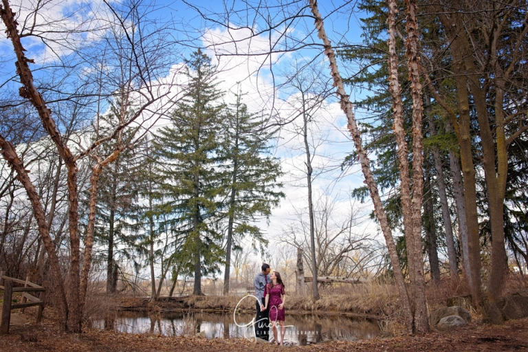 Couple holding their hands during their romantic early spring engagement session in Chicago suburbs