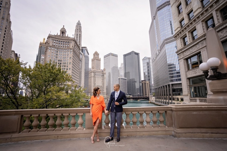 couple holding hands in front of wrigley building chicago