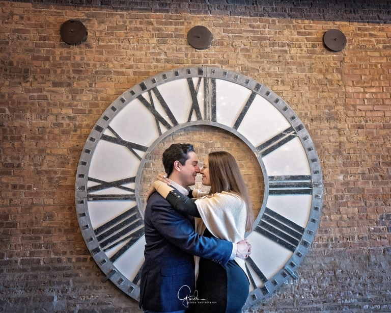artifact events proposal with couple hugging in front of large clock