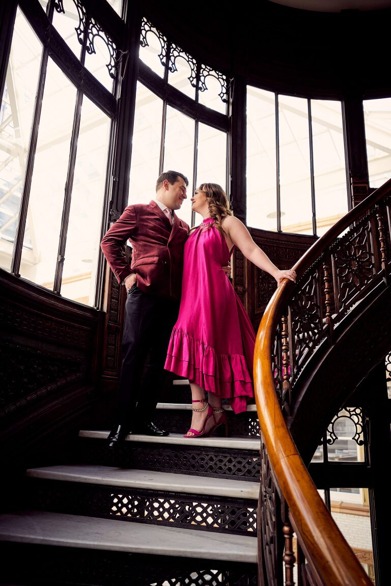 couple standing on the rookery building staircase
